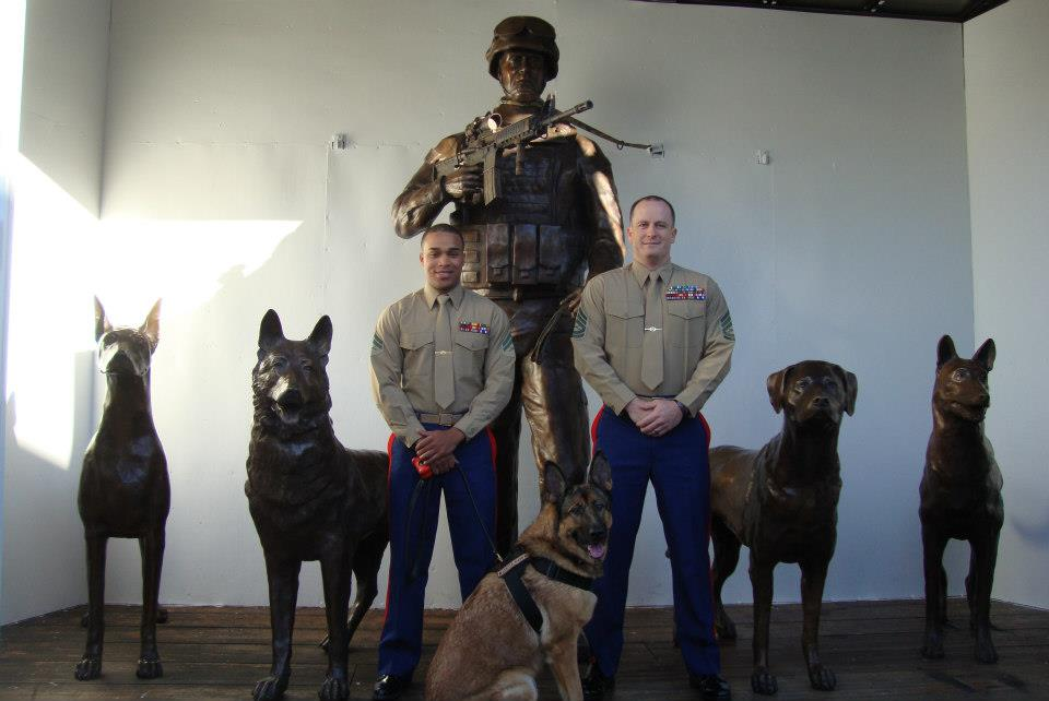 Lucca was the first MWD to view the Military Working Dog monument. Chris Willingham (right) and Juan Rodriguez (left) were Lucca's handlers during her Marine service. (Facebook: Lucca K458)