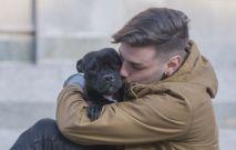 Man Hugging Dog Thumbnail